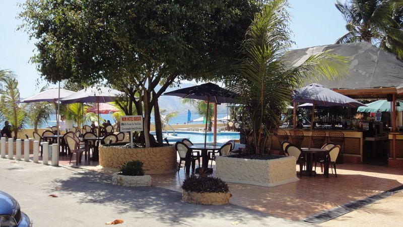 The pool, bar/resturant and parking area at the Treasure Island Beach Resort